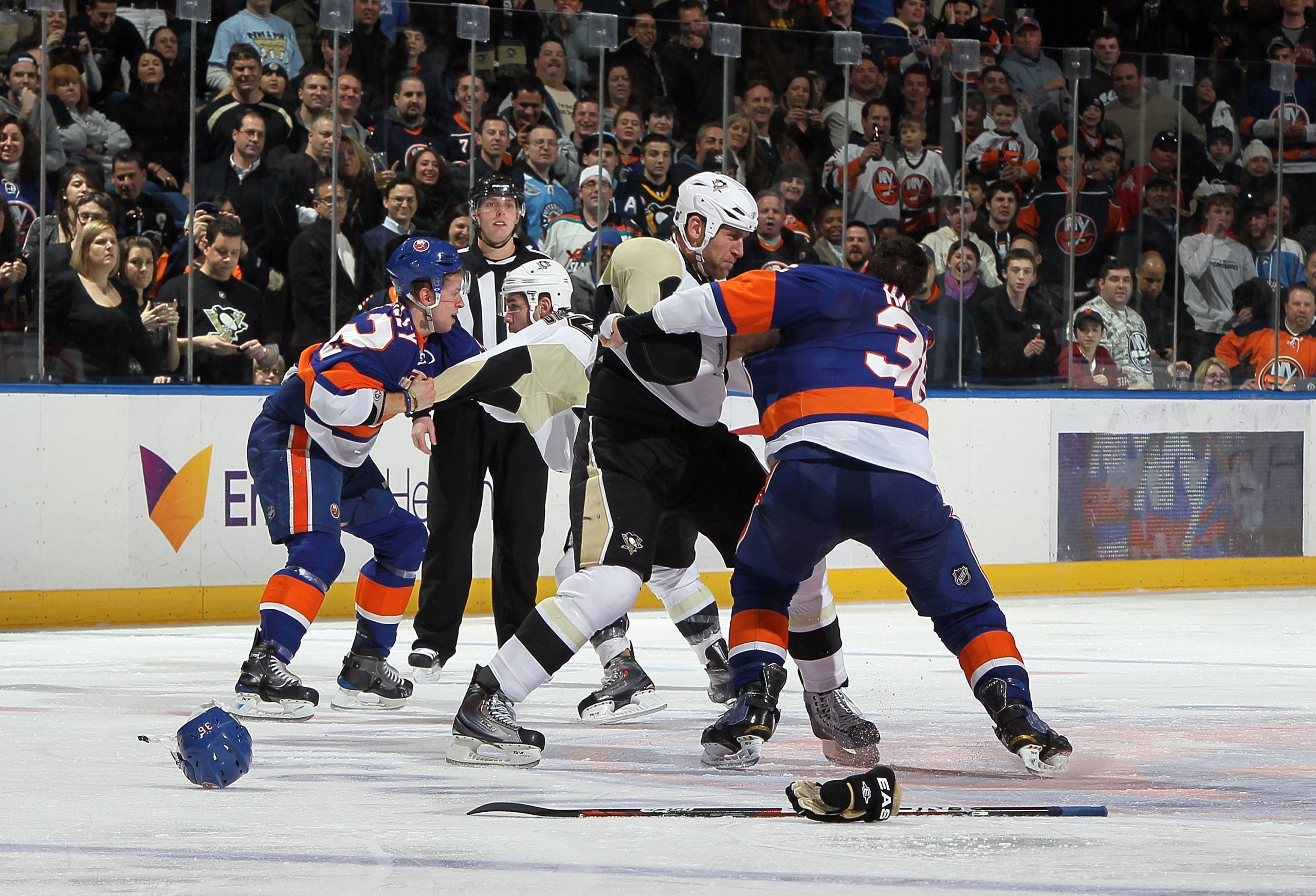 A hockey player with a crowd watching