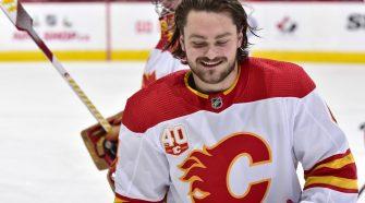 A hockey player looking at the camera