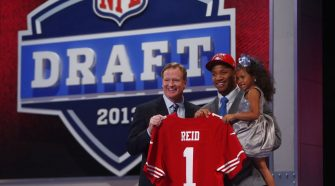 Roger Goodell, Eric Reid are posing for a picture