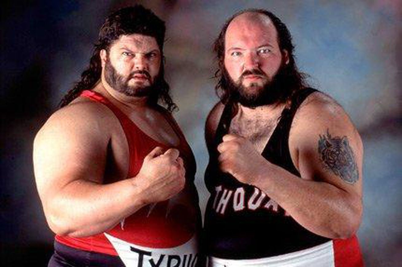 Fred Ottman, John Tenta are posing for a picture
