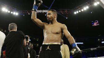 Andre Ward standing on a stage