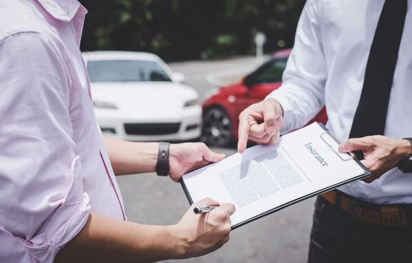 Man Signing on Insurance Policy