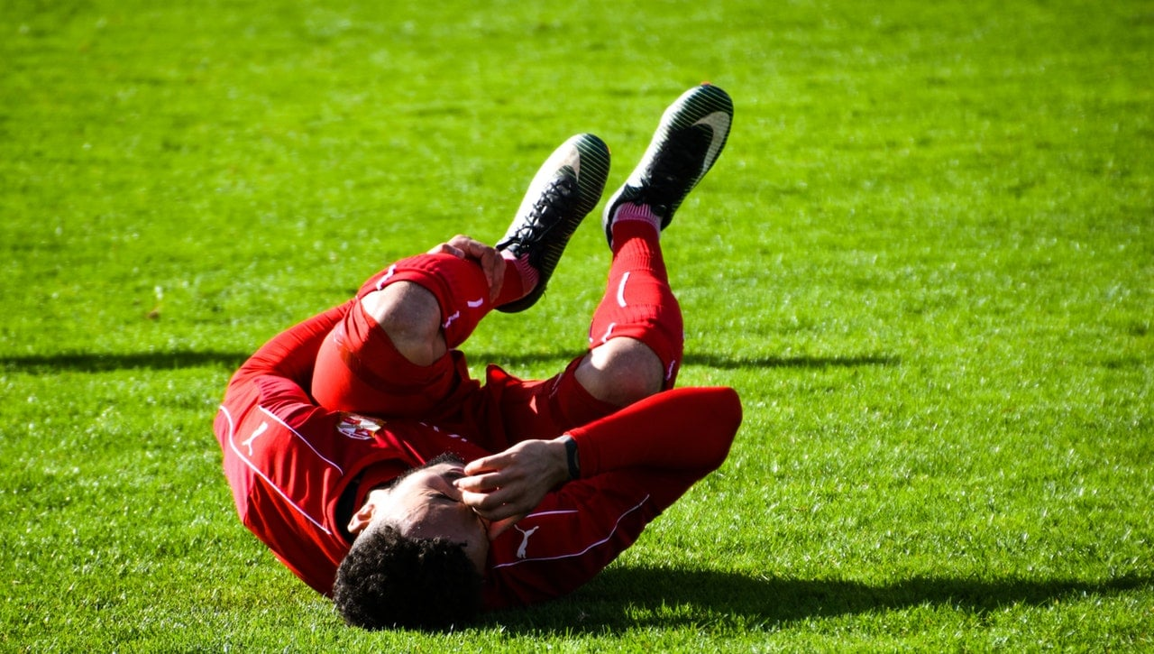 A Player injured and suffering